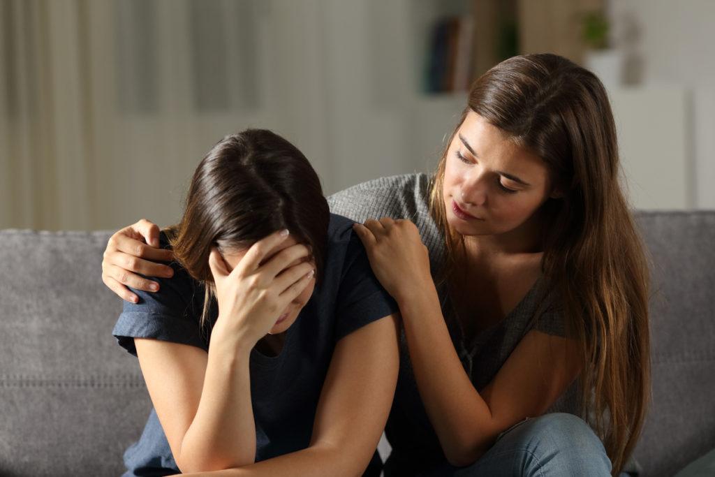 parent comforting grieving teen