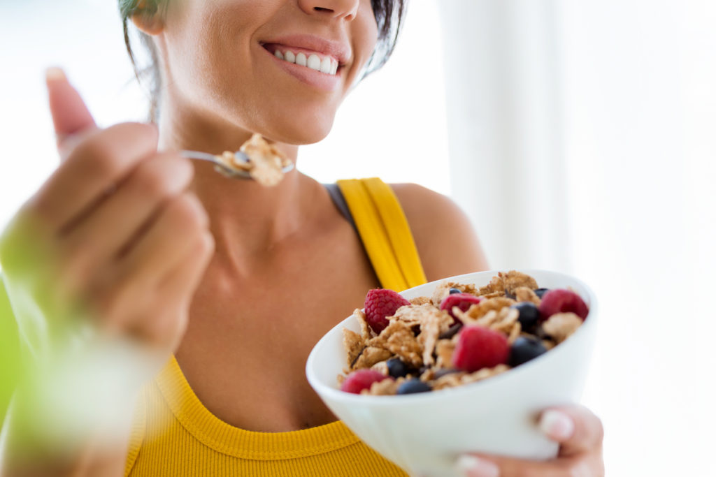 woman eating healthy food to improve her mood